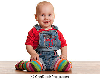 Happy sitting toddler in casual clothes