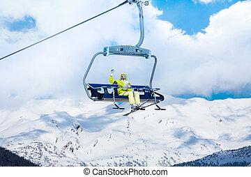 Happy skier in on the ski lift
