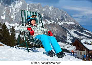 Happy skier in winter resort