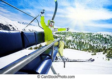 Happy skier on ski lift