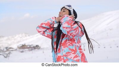 Happy skier pulling back hair - Single beautiful smiling...