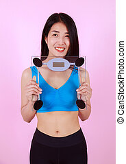 slim woman holding a weight scale