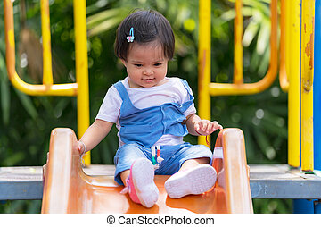 Happy small child on the playground in the park