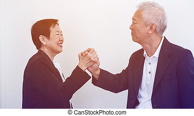 Happy smile Asian elderly couple in business attire, SME owner
