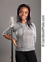 Happy smile by beautiful girl singer in studio - Beautiful...