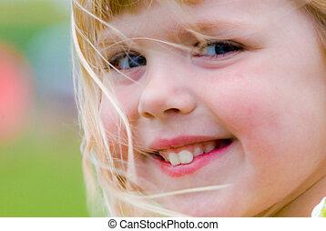 Happy Smile - Little blond girl smiling.