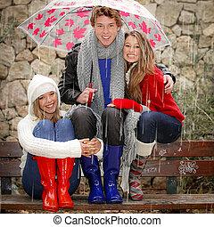 happy smiles in the rain with umbrella