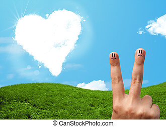 Happy smiley fingers looking at heart shaped cloud - Happy...