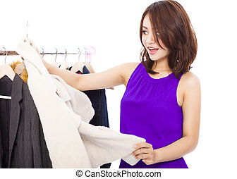 Happy smiling asian Woman shopping clothes over white background