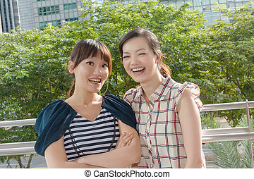 Asian woman with friends