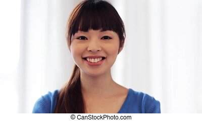 happy smiling asian young woman