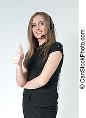 Happy smiling attractive call center operator. Sexy girl wearing headset. Showing big finger super sign. One of a series.