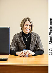 Happy smiling attractive woman with mug in hands
