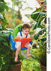 Happy smiling baby girl on swing