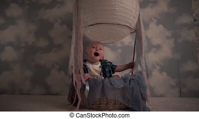 Happy smiling baby in a balloon