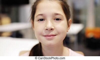 happy smiling beautiful preteen girl at school - education,...