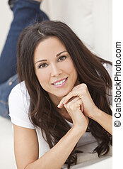Happy Smiling Beautiful Woman Laying on Sofa