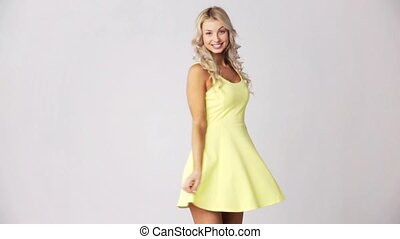 happy smiling beautiful young woman in dress