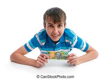Happy smiling boy holding money