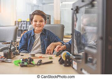 Happy smiling boy in studio - Hilarious little inventor is...