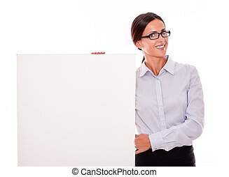 Happy smiling brunette businesswoman with placard