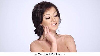Happy Smiling Brunette Woman Posing on White