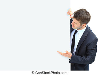 Happy smiling business man showing blank signboard, isolated over white background