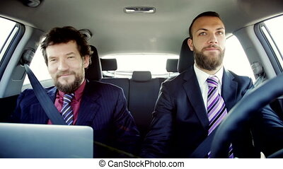 happy smiling business men in car