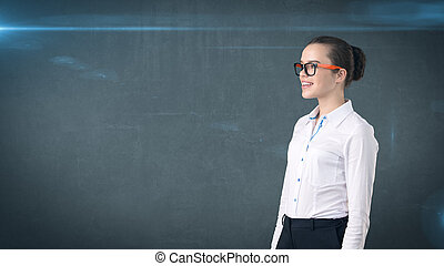 Happy smiling business woman portrait in white skirt on isolated background with copyspace looking at something.