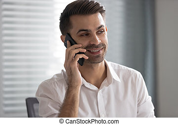 Happy smiling businessman talking on phone, making business call