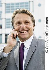 happy smiling businessman using cel