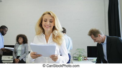 Happy Smiling Businesswoman Holding Report Document Over Her...