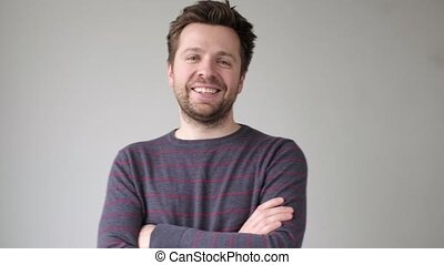 Happy smiling caucasian guy in sweater looking at camera