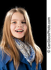 happy smiling caucasian little girl with teeth braces