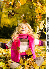 happy smiling child in autumn time