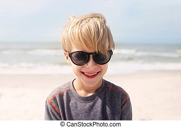 Happy Smiling Child on Beach by Ocean