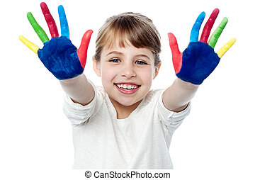 Happy smiling children playing with paint