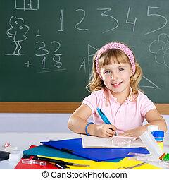 happy smiling children student girl at school classroom desk