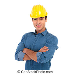 happy smiling construction engineer with hands crossed