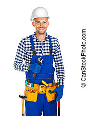 Happy smiling construction worker with wrench and tool belt