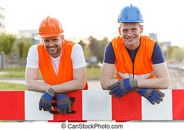 Happy smiling construction workers