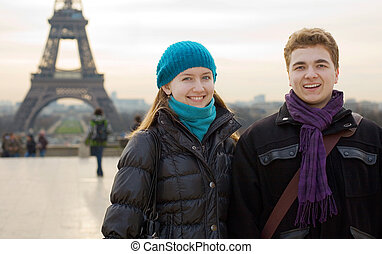 Happy smiling couple in Paris near the Eiffel Tower