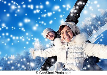 Happy smiling couple on a winter background