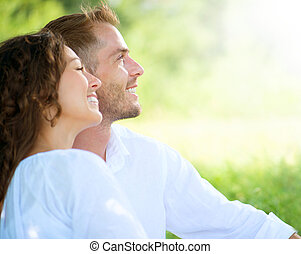 Happy Smiling Couple Relaxing in a Park. Picnic