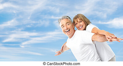 seniors couple - Happy smiling elderly seniors couple under...