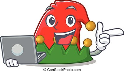 Happy smiling elf hat cartoon character working with laptop