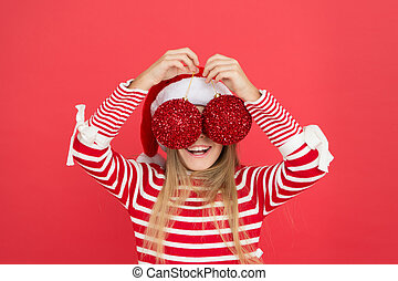 Happy smiling face. Beautiful detail. Positivity concept. Playful baby. Christmas party. Winter holidays. Playful mood. Christmas celebration ideas. Shine and glitter. Child Santa Claus costume hat