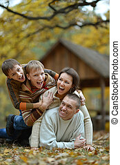 family having fun in autumn forest