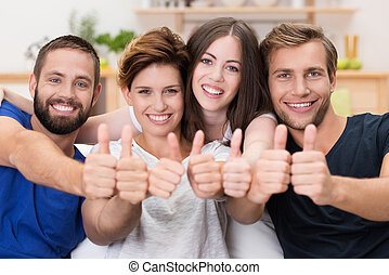 Happy smiling friends giving a thumbs up