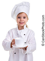 Happy smiling girl chef white uniform isolated on white background. Giving the white cup with a saucer. Portrait image